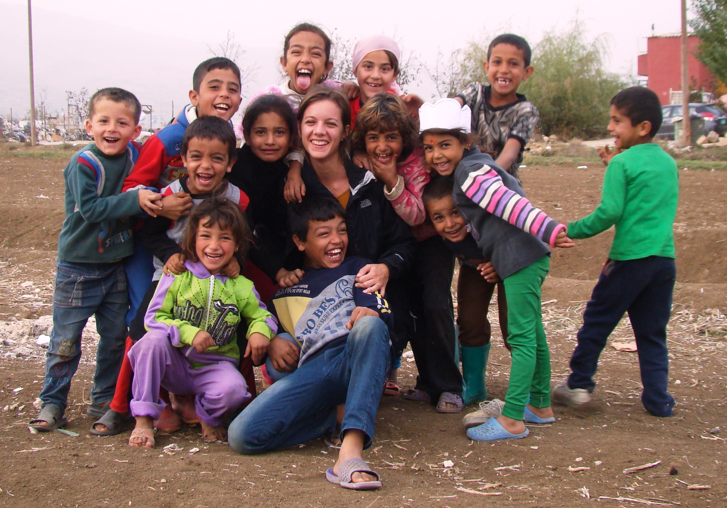 Photograph of volunteer and children from host community