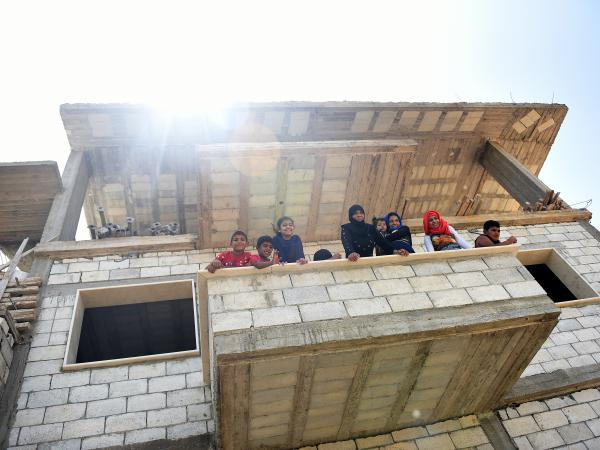 Syrian refugees in their home in Northern Lebanon